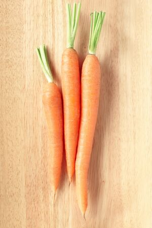 Fresh carrots on cutting board photo