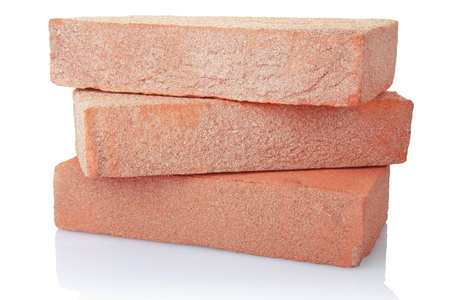 brique: Vieux pile de briques rouges