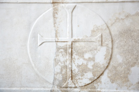 Cross carved in white marble background photo