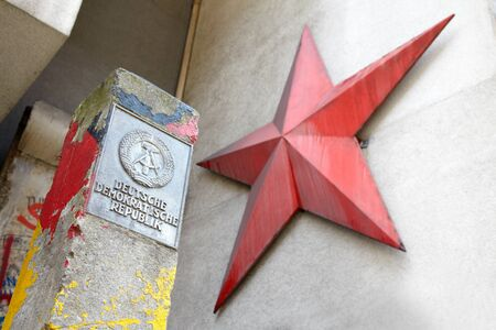 ddr: DDR sign and red star in Berlin Editorial