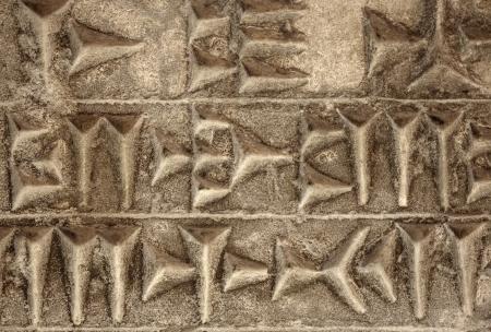 Cuneiform ancient writing on stone 스톡 콘텐츠