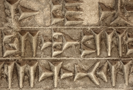 Cuneiform ancient writing on stone Imagens