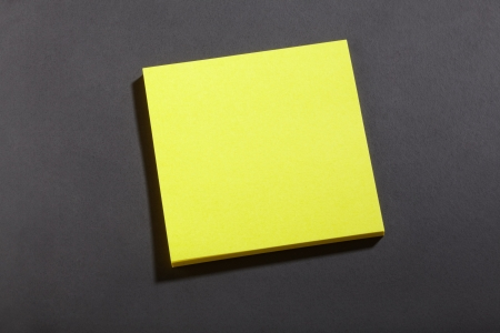 Yellow sticker block note on blackboard Stock Photo - 16672872
