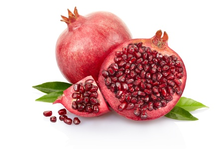 Pomegranate with leaves isolated on white, clipping path included Фото со стока