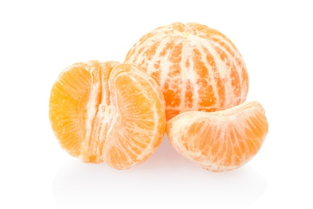 Tangerine or mandarin on white, clipping path included photo