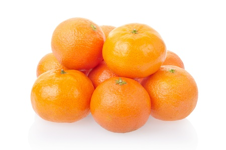 Tangerine or mandarin heap on white, clipping path included photo