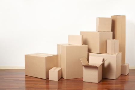 Cardboard boxes in apartment, moving day Stock Photo - 18842420