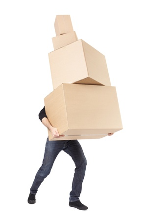 Moving day, man lifting cardboard boxes on white with clipping path Фото со стока
