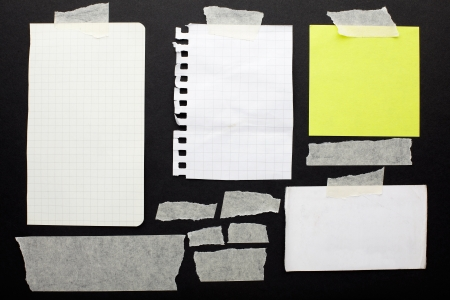 Torn paper scraps set and tape on black with clipping path photo