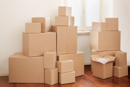Cardboard boxes in apartment, moving day Stock Photo - 19479620