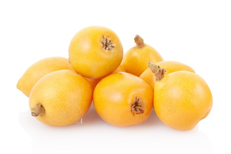 Loquat heap on white, clipping path included Stock Photo - 19883594