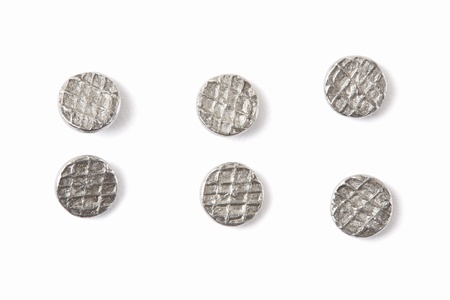Metal nails heads on white, clipping path included Фото со стока