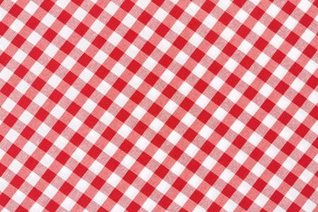 빨간색과 흰색 깅 검 식탁보 질감 배경