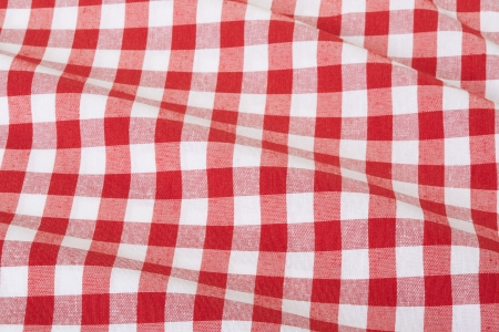 Red and white wavy tablecloth texture background photo