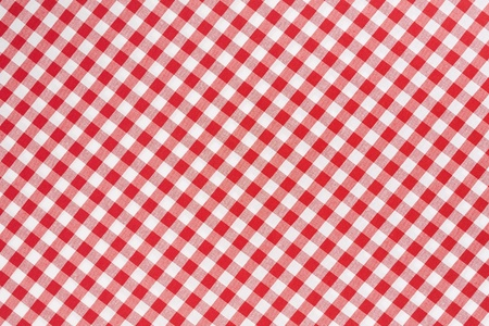 Red and white gingham tablecloth texture background photo