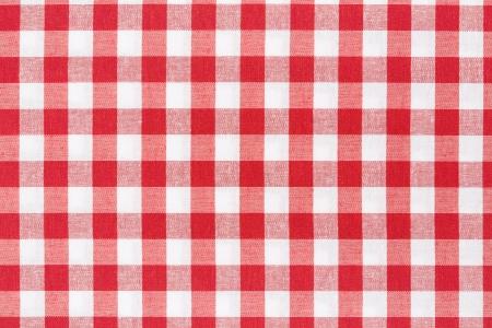 赤と白のギンガム チェックのテーブル クロスのテクスチャ背景