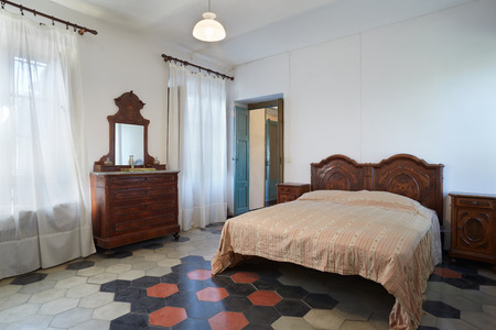 Old bedroom in country house in Italy photo