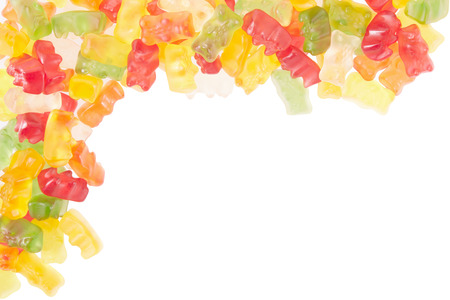 Gummy: Gummy bears candies border on white Stock Photo