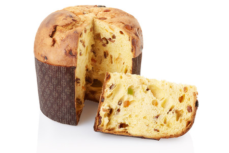 Panettone and slice isolated on white, clipping path