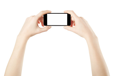 Smartphone in female hands taking photo isolated on white