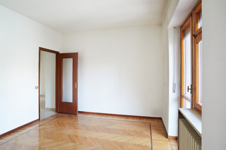 Empty room in normal apartment with wooden floor photo