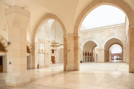 king hussein: King Hussein Bin Talal mosque arcade in Amman, Jordan Stock Photo