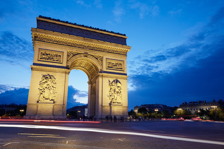 triumphal: Arc de Triomphe in Paris at night, France