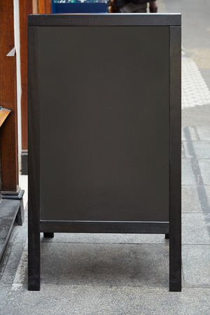 black board: Restaurant menu blank board on the street Stock Photo