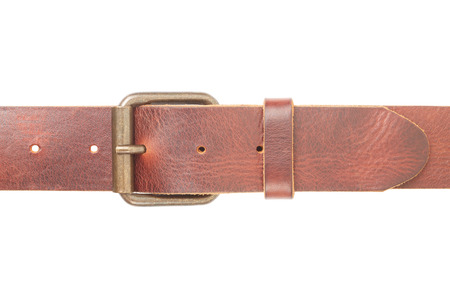 Brown leather belt with buckle on white, clipping path photo