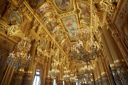 Opera Garnier golden interior in Paris Редакционное