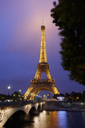 Eiffel tower in Paris at night with river view