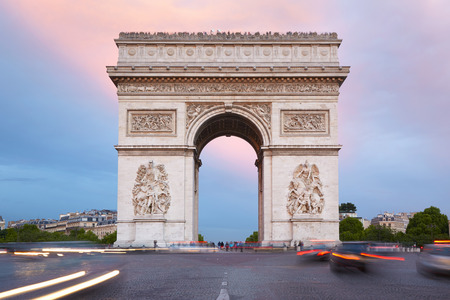 triumphal: Arc de Triomphe in Paris, France. Traffic in the morning.