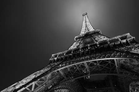 parisian: Eiffel tower in Paris at night, low angle view