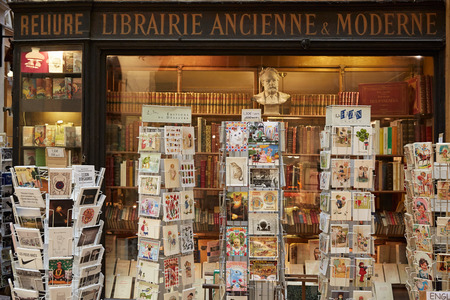 book shop: Paris, old library in Galerie Vivienne with ancient book and postcards