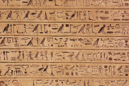 Egyptian hieroglyphics stone background Stock Photo