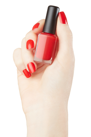 Woman hand manicure with red nail polish bottle, clipping path Stock Photo