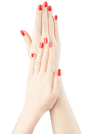 red nail colour: Manicure on woman hands with red nail polish, clipping path