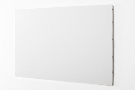 blank empty: White blank canvas on white wall.