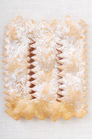chiacchiere: Chiacchiere, italian Carnival pastry on white tablecloth
