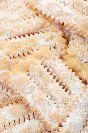 chiacchiere: Chiacchiere, italian Carnival pastry background Stock Photo