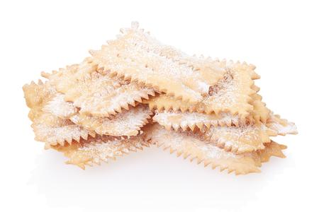 crostoli: Chiacchiere, italian Carnival pastry heap on white.