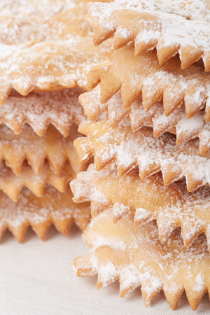 crostoli: Chiacchiere, italian Carnival pastry heap on white tablecloth
