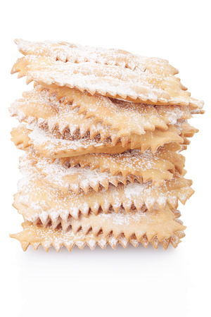 crostoli: Chiacchiere, italian Carnival pastry pile on white, clipping path