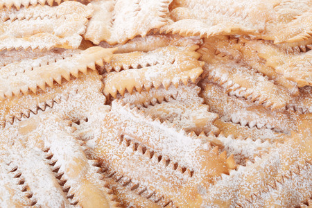 chiacchiere: Chiacchiere, italian pastry background Stock Photo
