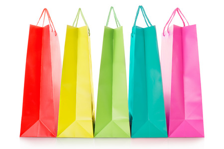 Colorful shopping bags in paper on white