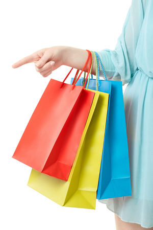 woman bag: Woman hand holding shopping bags pointing at on white clipping path