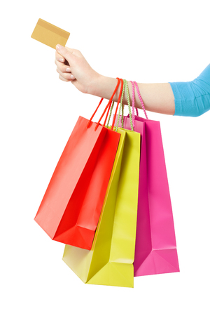 yellow card: Woman hand holding shopping bags and credit card on white clipping path
