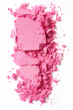 Pink, crushed eye shadow isolated on white, clipping path included photo