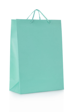 Blue shopping bag in paper on white clipping path