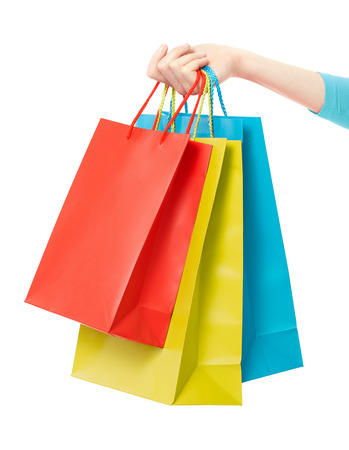 Woman hand holding shopping bags on white clipping path 스톡 콘텐츠
